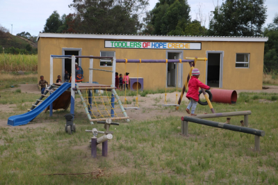 Toddlers and Hope's new great facilities with buildings, walled outdoor areas and play equipment